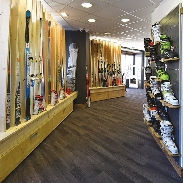 Rake of ski boots and skis for sale at Mountain Story